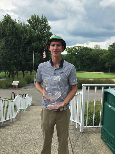 Grant Godfrey poses with his trophy after winning the Greater Cleveland Amateur Championship Sunday at Sleepy Hollow Golf Course.