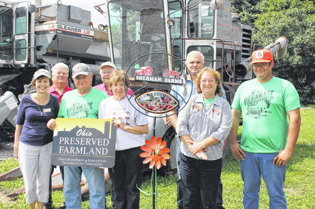 Members of the Sherman family of Porter Township were recognized for their commitment to agriculture by the Delaware County Board of Commissioners represented by Commissioner Barb Lewis. Pictured, left to right, front row: Barb Lewis, Jim Sherman, Susan Sherman, Denise Sherman and Bob Sherman; back row: Delaware Soil & Water Conservation District Board of Supervisors Ted Colflesh, Steve Sheets and Dan Lane.