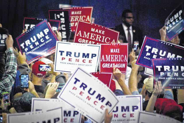 Before and after GOP presidential candidate nominee Donald Trump stepped to and from the Delaware County Fairgrounds Coliseum stage in October 2016, supporters were cheering and waving his signs in support of his candidacy for president of the U.S.