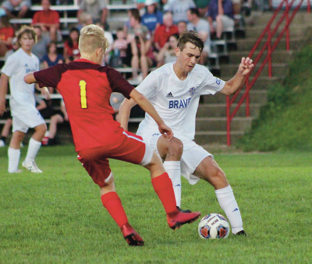 Olentangy's Drew Clement works around a Big Walnut defender during the first half of Tuesday's non-league showdown in Sunbury.