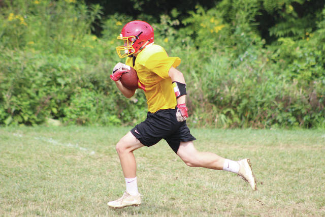 Big Walnut's Jimmy Gianessi finds some running room during a practice earlier this summer.