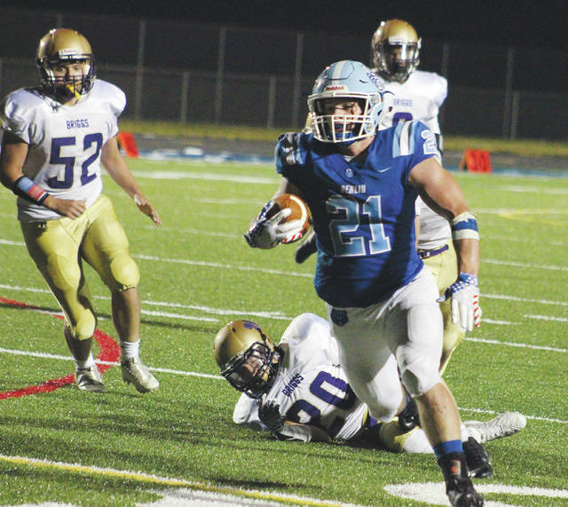 Olentangy Berlin's Johnny Spinner (21) finds some running room during the second half of Friday's season opener against visiting Briggs.