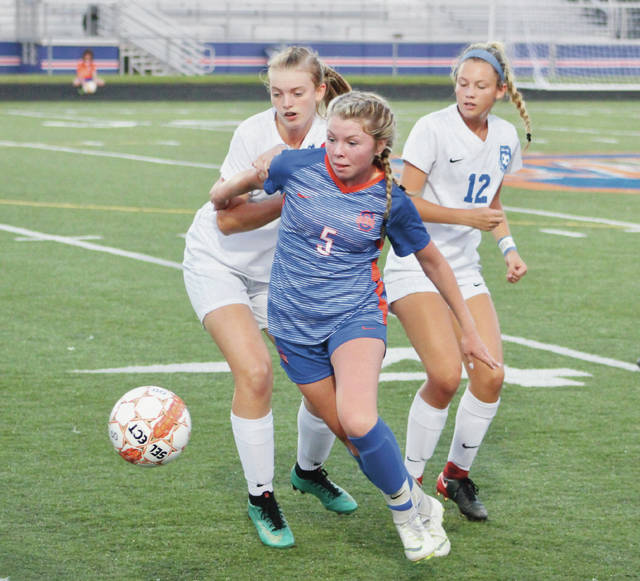 Orange's Maia Kaufman (5) breaks away from Liberty's Caitlin Curmode and Gia Gaetano (12) during the first half of Thursday's OCC-Buckeye showdown in Lewis Center.