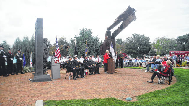 Dr. Nina Helene, a Salvation Army volunteer who served at Ground Zero, speaks during the Westerville 9/11 Memorial Observance in First Responders Park. Next to her is C-40, a piece of steel originally from the north tower of the World Trade Center.
