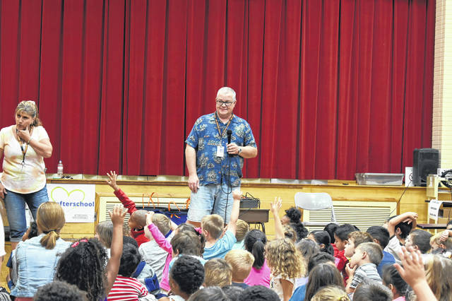 Bus drivers Scott Russell and Kim Kirk give a presentation to students at Woodward Elementary School about bus safety and procedure.