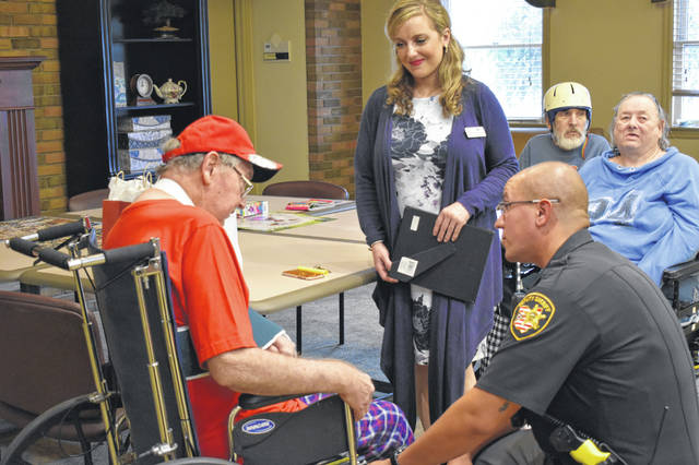 Delaware County Sheriff's Deputy John Hicks speaks to U.S. Army veteran Ed Berwinkle Tuesday afternoon at the Country Club Rehabilitation Campus. Hicks spoke to and thanked several veterans for their service Tuesday to commemorate Patriot Day.
