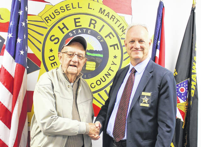 """Pictured are former Delaware County Sheriff Eugene Jackson, left, with current Sheriff Russell Martin, right, at the Delaware County Sheriff's Office in 2016. Martin said Monday that he was grateful for the 2016 visit. He added Jackson was """"a true hero who served not only his country, but the citizens of Delaware County as a well-respected sheriff from 1966 to 1976."""""""