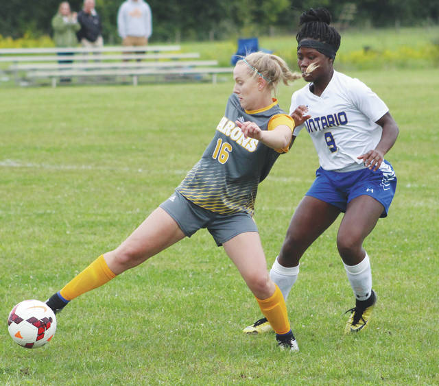 Buckeye Valley's Liz Gedde (16) works on an Ontario defender during the second half of Monday's MOAC showdown in Delaware.