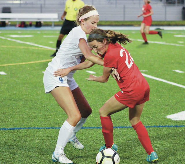 Olentangy Berlin's Hannah Wilt and Big Walnut's Adalee Gartner, right, battle for possession during the first half of Tuesday's non-league showdown in Delaware.