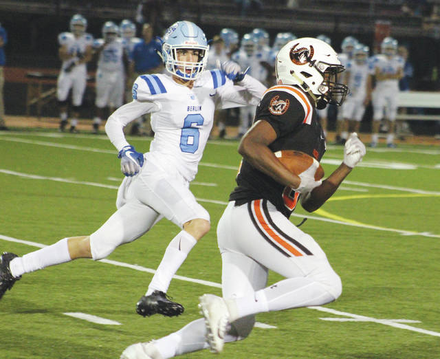 Olentangy Berlin's Aidan Pettograsso (6) pursues Hayes' Nabil Abdus-salaam during the third quarter of Friday's OCC opener in Delaware.