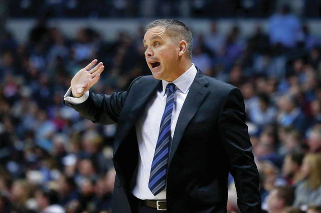 In this Feb. 26, 2017, file photo, Butler head coach Chris Holtmann directs his players from the bench in the second half of an NCAA college basketball game against Xavier in Cincinnati. Holtmann will replace Thad Matta as the head coach at Ohio State, the school announced Friday, June 9.