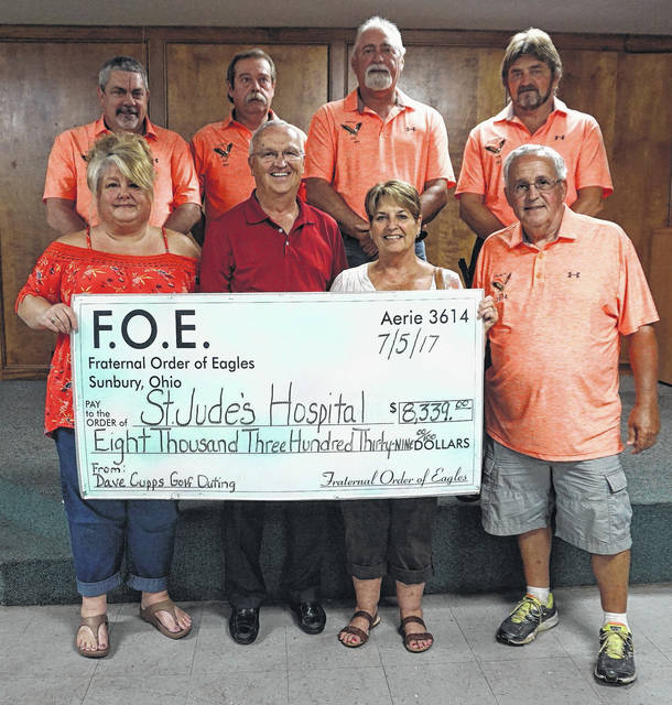 Members of the Sunbury Eagles and the Adkins family stand with a check donation to St. Jude's Hospital. Front row, left-to-right: Jody Shoaf, Darrel Adkins, Phyllis Adkins, Larry Conard. Back row: Chris Norman, Vince Byers, Roger Stephens, Jeff Bradford.