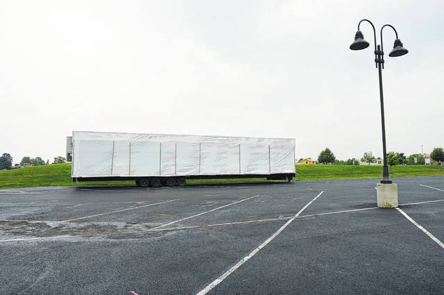 A new classroom trailer sits in the parking lot of General Rosecrans Elementary School on July 6. The trailer was going to be anchored on the basketball court to save costs.