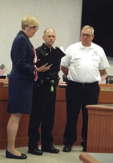 Mayor Carolyn Kay Riggle, left, reads a proclamation to Police Chief Bruce Pijanowski and Fire Chief John Donahue at the Delaware City Council meeting on Monday. September is National Preparedness Month.