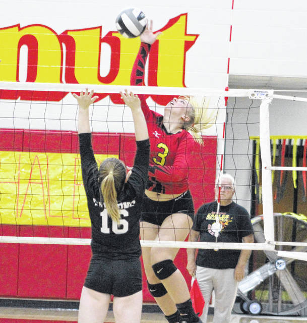 Big Walnut's Emma Urhammer (3) hammers home a kill during the first set of Thursday's OCC showdown against visiting Franklin Heights.