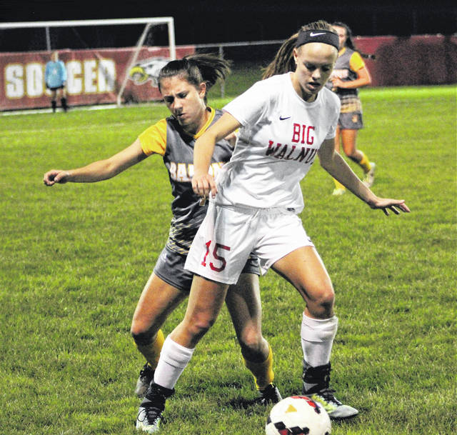 Big Walnut's Alexis Schone (15) and Buckeye Valley's Kennedy Wirth battle for possession during the first half of Thursday's Division II district tournament game in Sunbury.