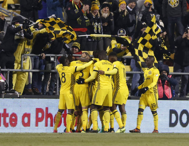 Columbus Crew players celebrate their goal against New York City FC during the second half of an MLS Eastern Conference semifinal soccer match Tuesday, Oct. 31, 2017, in Columbus, Ohio. The Crew beat New York City FC 4-1.