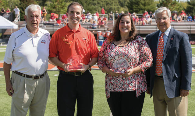From left are Bill Robinson, Justin Schultz, Stephanie (Spirer) Crandall and ONU President Daniel DiBiasio.