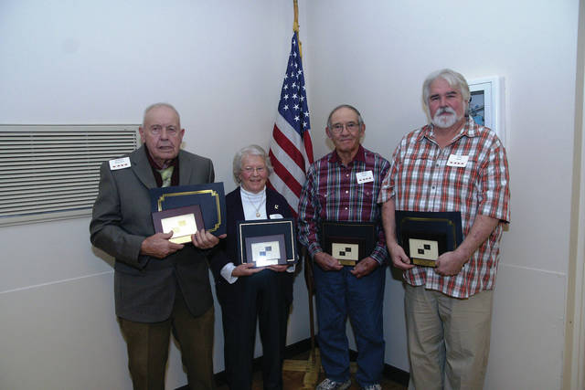 Hall of Fame winners, L to R, are: Bill Thurston (receiving award for Shirley Thurston), Donna Morton, Charles Lynn and Tom Stout (receiving award for Ramona Stout)