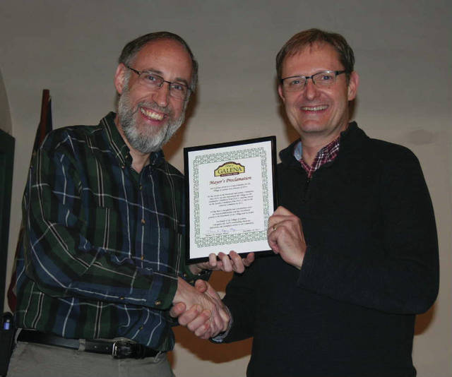 Mayor Thomas Hopper (left) presented a Mayor's Proclamation to retiring Council member Joe Stoll (right).