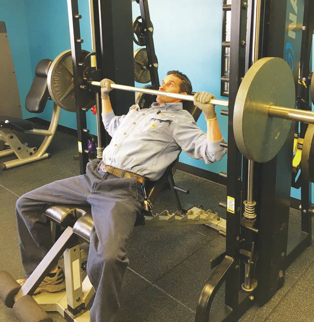 American Showa, Inc. employee Jeremy Flahive exercises in the Showa Fitness Center on his lunch break.