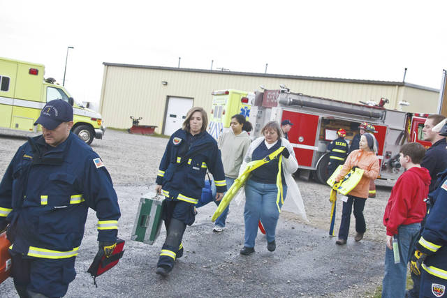 "This photo from a previous Citizen Academy shows EMS staff and Academy students ""working an incident."""