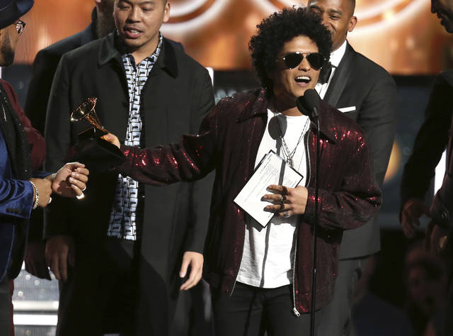 "Bruno Mars accepts the award for song of the year for ""That's What I Like"" at the 60th annual Grammy Awards at Madison Square Garden on Sunday, Jan. 28, 2018, in New York. (Photo by Matt Sayles/Invision/AP)"