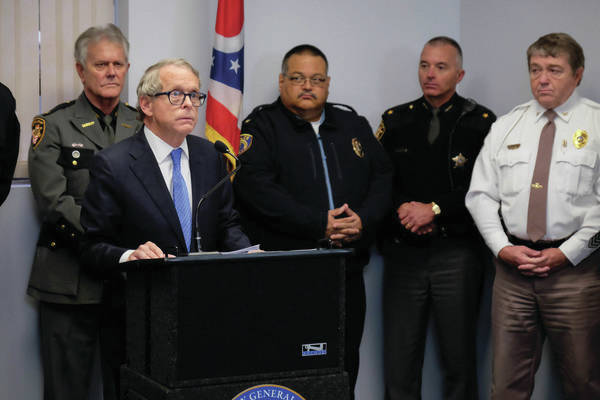 Mike DeWine discusses the fight against opioid abuse with law enforcement backing him.