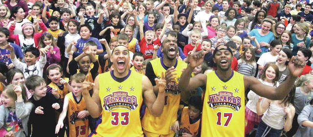 Members of the Harlem Wizards with some of their many young fans.