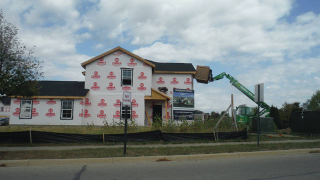 In a photo taken last summer, a corner unit of a Sunbury Pointe apartment is being constructed by Preferred Living. Officials with owner-managers Champion Companies say the work will be completed this fall.