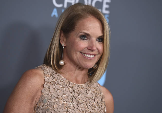 FILE - In this Jan. 11, 2018 file photo, Katie Couric poses in the press room at the 23rd annual Critics' Choice Awards in Santa Monica, Calif. Couric and leaders of household consumer products maker Procter & Gamble highlight a forum planned to examine the state of women in the workplace. P&G and Seneca Women, which advocates for global female advancement, are co-hosting the #WeSeeEqual forum Thursday at the company's Cincinnati headquarters. (Photo by Jordan Strauss/Invision/AP, File)