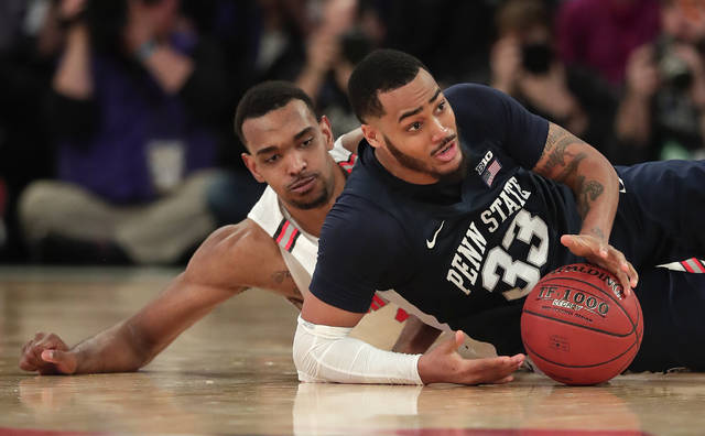 Penn State guard Shep Garner (33) looks to pass as he scrambles against Ohio State forward Keita Bates-Diop (33) during the second half of an NCAA Big Ten Conference tournament college basketball game, Friday, March 2, 2018, in New York. Penn State won 69-68. (AP Photo/Julie Jacobson)