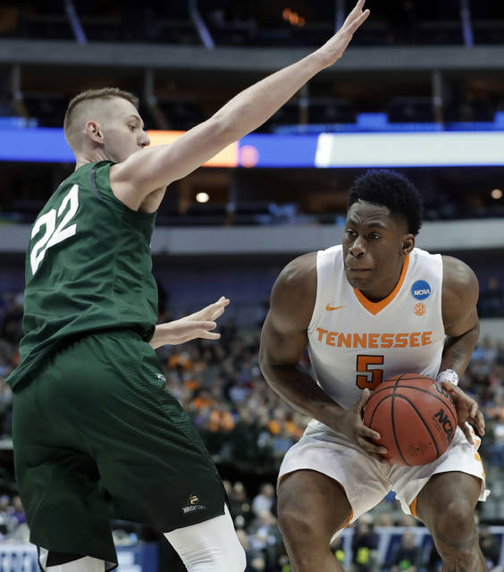 Wright State center Parker Ernsthausen defends as Tennessee forward Admiral Schofield positions for a shot in the first half of the first round of the NCAA men's college basketball tournament in Dallas Thursday