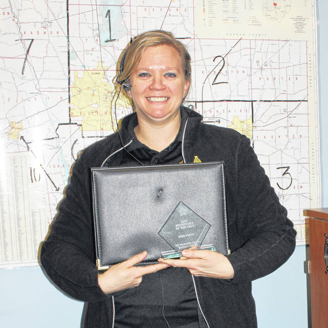Dispatcher of the Year Erin Mann poses with her award on Monday, March 12. Mann was unable to attend the awards ceremony because she was working at the dispatch center at the time.