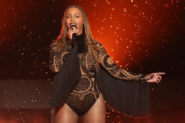 "FILE - In this June 26, 2016, file photo, Beyonce performs ""Freedom"" at the BET Awards in Los Angeles. When Beyonce paid tribute to historically black colleges at Coachella, the singer's grand performance reignited interest in the marching band culture creating shockwaves of excitement to students attending those schools. Many from the black community are praising Beyonce for shedding light on HBCUs. Her high-energy festival set over the weekend involved a marching band, dance troupes and step teams from black colleges along with her singing ""Lift Every Voice and Sing,"" known as the national black anthem. (Photo by Matt Sayles/Invision/AP, File)"