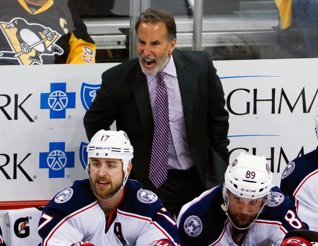 FILE - In this April 20, 2017, file photo, Columbus Blue Jackets head coach John Tortorella has words for a referee during the third period in Game 5 of an NHL first-round hockey playoff series against the Pittsburgh Penguins in Pittsburgh. The Blue Jackets played one more playoff game this season than last, but it's all the same to general manager Jarmo Kekalainen and coach John Tortorella. Not good enough.(AP Photo/Gene J. Puskar, File)