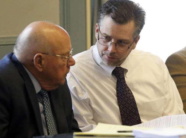 Shawn Grate, right, talks with his attorney Robert Whitney during the first day of his trial in Ashland, Ohio, Monday, April 23, 2018. Grate is charged with the 2016 killings of two women and the abduction of another. (Tom E. Puskar/The Times Gazette via AP)