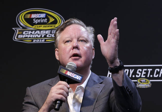 "FILE - In this Nov. 20, 2016, file photo, NASCAR CEO and Chairman, Brian France, talks to reporters during a news conference before a NASCAR Sprint Cup auto race practice in Homestead, Fla. NASCAR President Brent Dewar has told employees the France family ""remains dedicated to the long term growth of our sport."" The memo was sent to employees on Tuesday, May 8, 2018, one day after a media report said the France family was exploring the sale of its stake in the nation's top auto racing series. (AP Photo/Alan Diaz, FIle)"