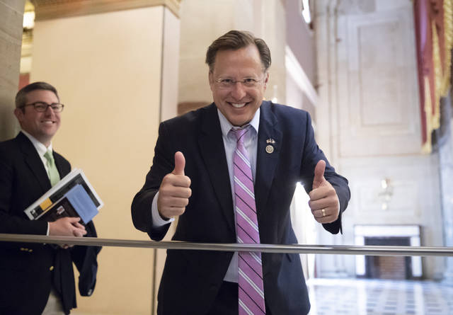 Rep. Dave Brat, R-Va., a member of the conservative House Freedom Caucus, smiles before the vote on the House farm bill which failed to pass, at the Capitol in Washington, Friday, May 18, 2018. The Freedom Caucus opposed the measure, seeking leverage to obtain a vote on a hard-line immigration plan. Last week's display of anarchy among House Republicans on immigration underscores how problematic and risky the issue is for a GOP that badly needs unity heading into November elections that will decide control of Congress. (AP Photo/J. Scott Applewhite)