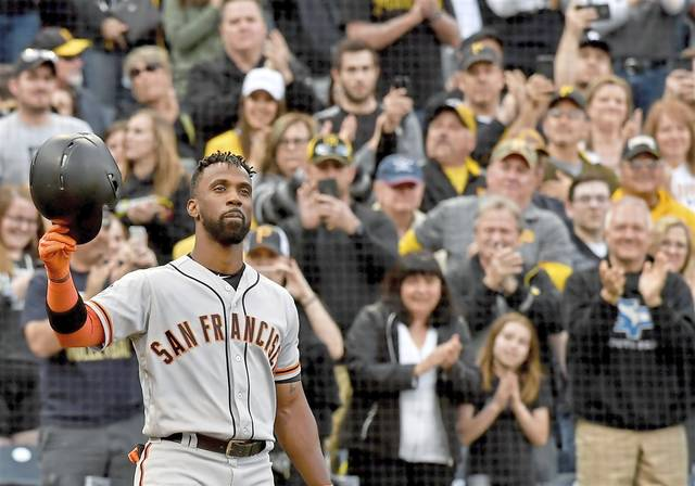 San Francisco Giants right fielder Andrew McCutchen acknowledges a standing ovation from the crowd in the first inning against the Pirates Friday, May 11, 2018 at PNC Park.