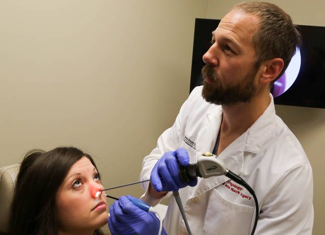 Dr. Brad Otto uses a non-invasive sinus procedure on a patient. A new clinical trial at The Ohio State University Wexner Medical Center is examining how the new approach to sinus procedures can help patients with chronic symptoms improve their nasal airflow.