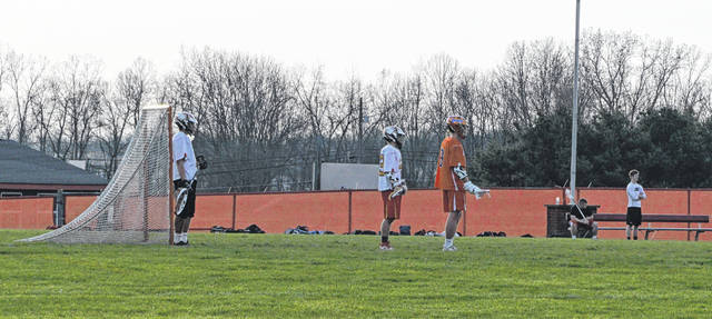 Josh Hageman stands in goal during the Big Walnut-Olentangy Orange varsity boys lacrosse match on April 26. Hageman made 15 saves in a 16-9 loss.