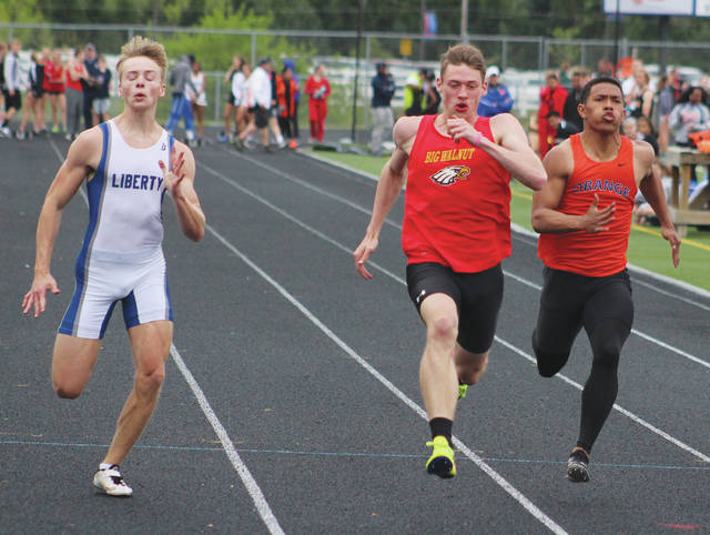 Big Walnut's Tim Rumas, center, edges Liberty's Andrew Bendick and Orange's Brandon Ransom at the finish line to win the 100-meter dash during Friday's Elite 8 Delaware County Championship at Orange. Rumas won with a time of 10.82 seconds.