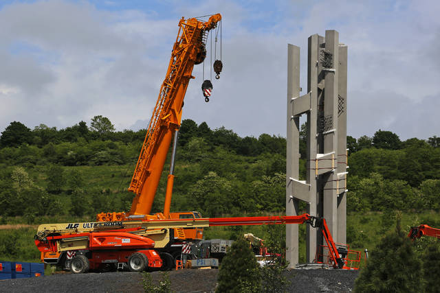 This May 31, 2018, photo shows the first section of the 93-foot tall Tower of Voices wind chimes is in place at the Flight 93 National Memorial in Shanksville, Pa. The final phase of the memorial is underway and on track to open on the 17th anniversary of plane's crash into a Pennsylvania field during 9/11. (AP Photo/Gene J. Puskar)