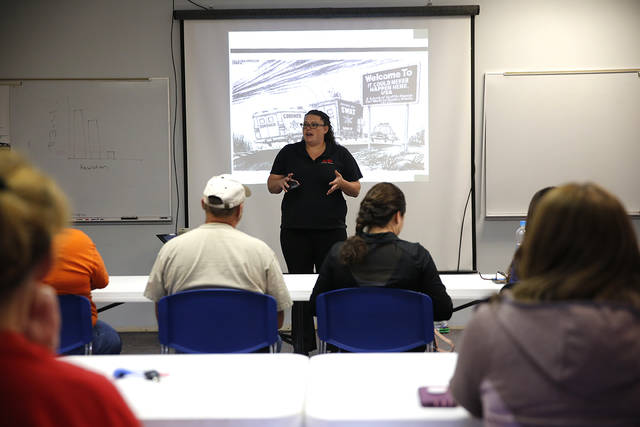 In a Thursday, May 10, 2018 photo, Andrea Nester, risk manager for Natrona County School District, talks to school staff from various parts of the county during an ALICE training class in Casper, Wyoming. The mandatory training teaches staff how to react in the event of a school shooting. (Josh Galemore/The Casper Star-Tribune via AP)
