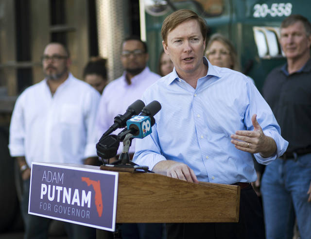 FILE - In this April 6, 2018, file photo, Adam Putnam, Republican gubernatorial candidate makes a campaign stop at Kimmins Contracting in Tampa, Fla. The state of Florida failed to conduct national background checks on tens of thousands of applications for concealed weapons permits for more than a year, according to an Office of Inspector General report released Friday, June 8. Putnam is the Commissioner of the Florida Department of Agriculture and Consumer Services which is charged with conducting background checks on concealed weapons permit applications. (Monica Herndon /Tampa Bay Times via AP, File)