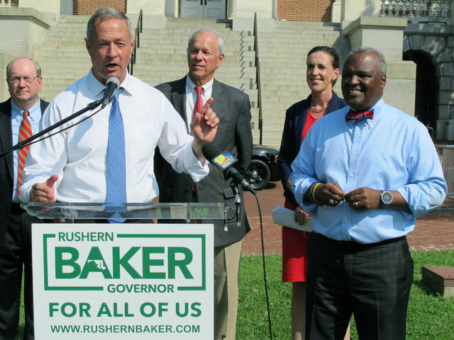 FILE - In this June 7, 2018 file photo, former Gov. Martin O'Malley, front left, endorses Prince George's County Executive Rushern Baker, right, for governor of Maryland, in Annapolis, Md. With two leading candidates who have a shot at becoming Maryland's first black governor, the crowded Democratic gubernatorial primary reflects the state's changing demographics and the party's efforts to harness the energy of an increasingly diverse electorate around the country. Recent polls show former NAACP President Ben Jealous and Baker are leading in a close and crowded primary.  (AP Photo/Brian Witte, File)