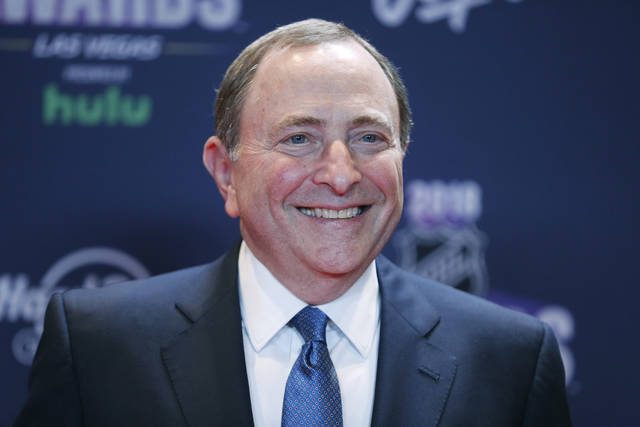 FILE - In this June 20, 2018, file photo, Gary Bettman, commissioner of the National Hockey League, poses on the red carpet before the NHL Awards in Las Vegas. Bettman was selected to the Hockey Hall of Fame, Tuesday, June 26, 2018. (AP Photo/John Locher, File)
