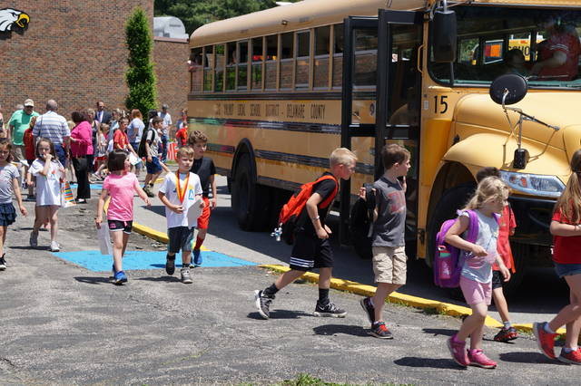"Thursday, May 24, was the last day of school for students at Big Walnut Local Schools. Classes let out two hours early at Big Walnut Elementary School, and the parking lot was full of parents ready to take their kiddos home. The students said their goodbyes, saying, ""See you next (school) year,"" as they boarded their bus. Some ran from the building, but most walked away, maybe half accompanied by adults. One young boy was crying as he was led away by his mom. Aboard the buses, the youngsters were waving and high-fiving, chanting ""No School"" and ""Freedom."" The full buses pulled away, horns tooting, as the teachers waved back to the children."