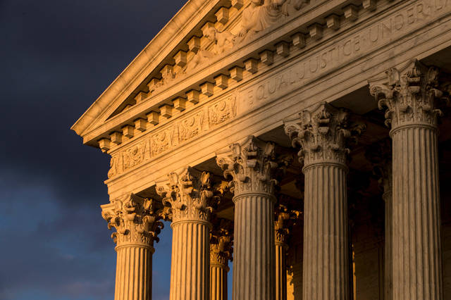 FILE - In this Oct. 10, 2017, file photo, the Supreme Court in Washington is seen at sunset. States will be able to force shoppers to pay sales tax when they make online purchases under a Supreme Court decision June 21, 2018, that will leave shoppers with lighter wallets but is a big win for states. (AP Photo/J. Scott Applewhite, File)